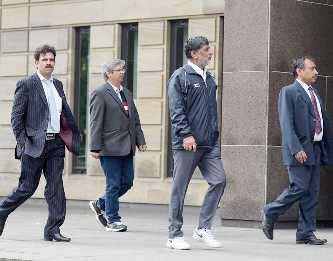 Uttar Pardesh Olympic Association secretary Anandeshwar Pandey, second right, and Sancheti arrive at Sheriff court of Glasgow on Monday