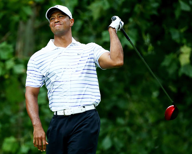 Tiger Woods of the United States reacts on the seventh tee during the second round of the 96th PGA Championship at Valhalla Golf Club in Louisville, Kentucky on Friday