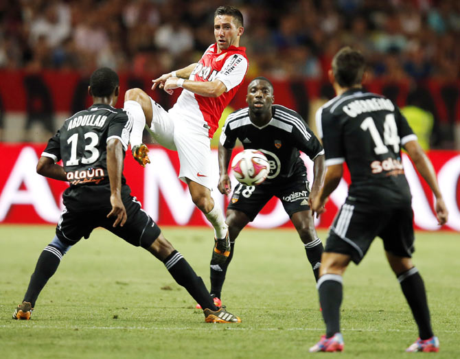Monaco's Ricardo Silveira De Carvalho (centre) challenges Lorient's Raffidine Abdullah (left) and Raphael Guerreiro during their French Ligue 1 soccer match at Louis II stadium in Monaco on Sunday