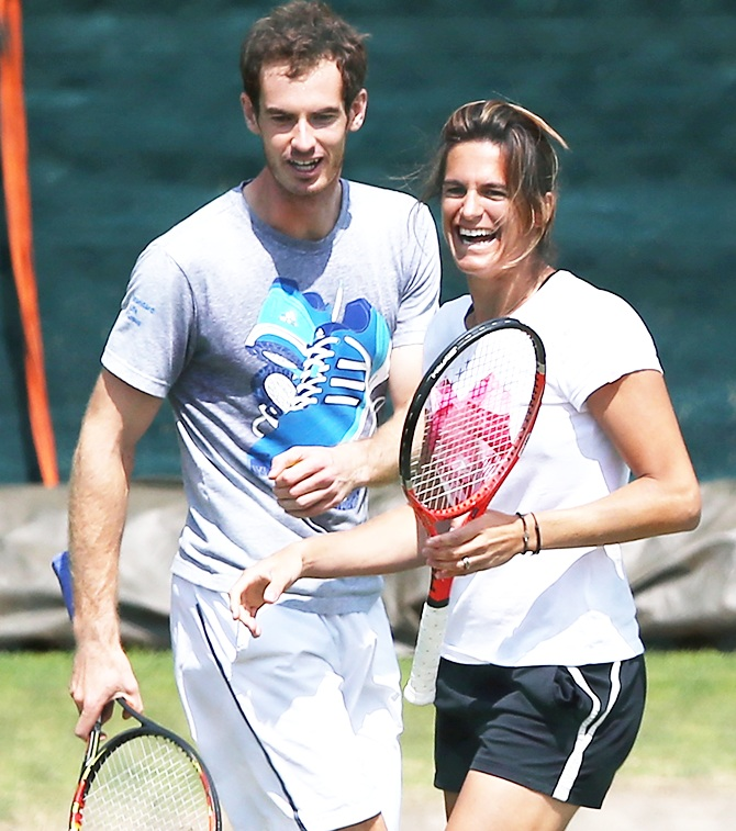 Andy Murray of Great Britain with coach Amelie Mauresmo during a practice session