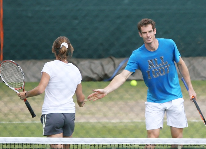 Andy Murray of Great Britain shakes hands with his coach Amelie Mauresmo