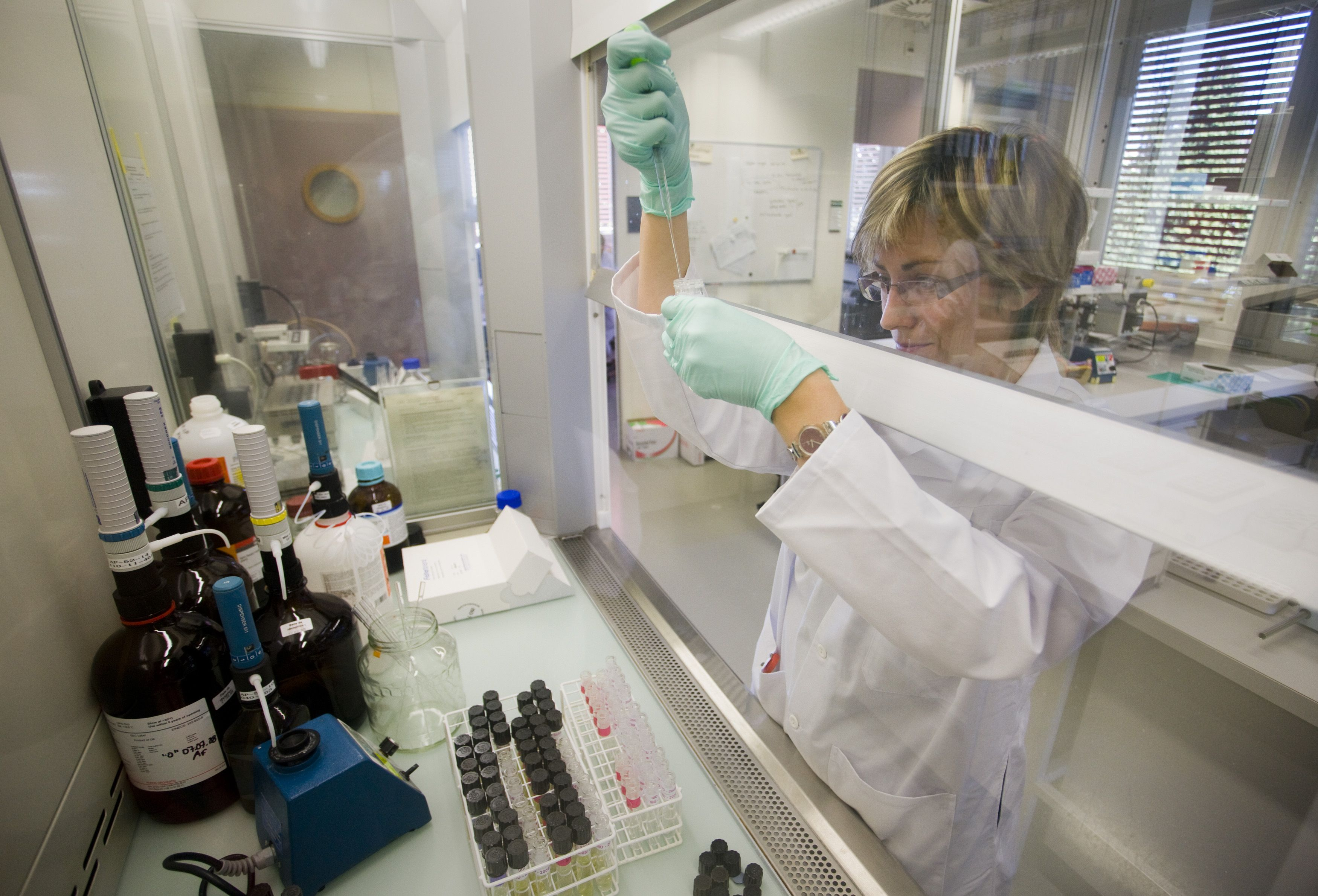 A technician prepares urine sample for testing at the Swiss Laboratory for Doping Analysis