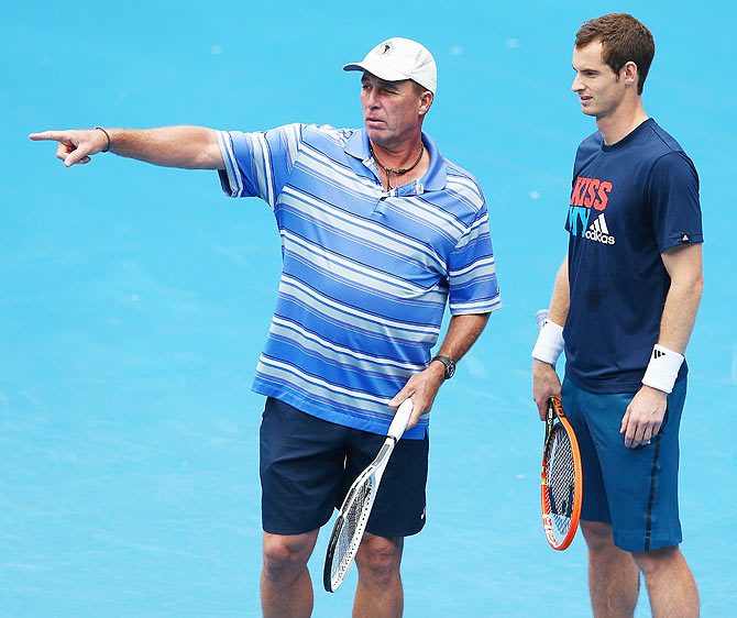 Andy Murray of Great Britain talks to his coach Ivan Lendl during a practice session