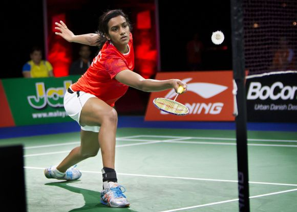 Sindhu dribbles at the net during the Badminton World Championships in Copenhagen. During her early days in training, 'There weren't many girls of Sindhu's calibre, so she always trained with the boys.'
