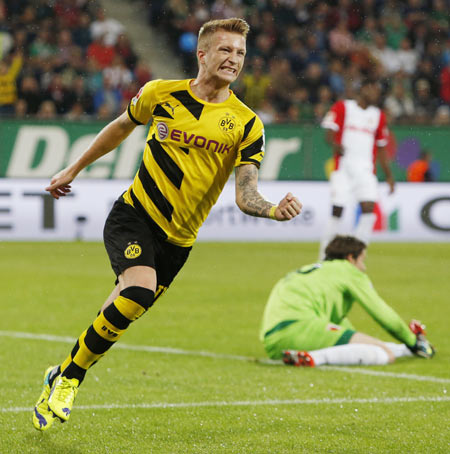 Borussia Dortmund's Marco Reus celebrates a goal against Augsburg during the German Bundesliga first division soccer match in Augsburg on Friday
