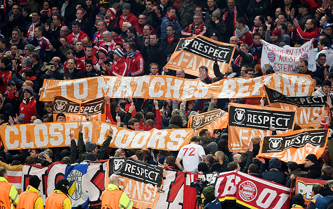 Bayern Munich fans hold up protest banners during the UEFA Champions League Group E match between Manchester City and Bayern Muninvh at the Ethad Stadium in Manchester on November 25. Photograph: Michael Regan/Getty Images