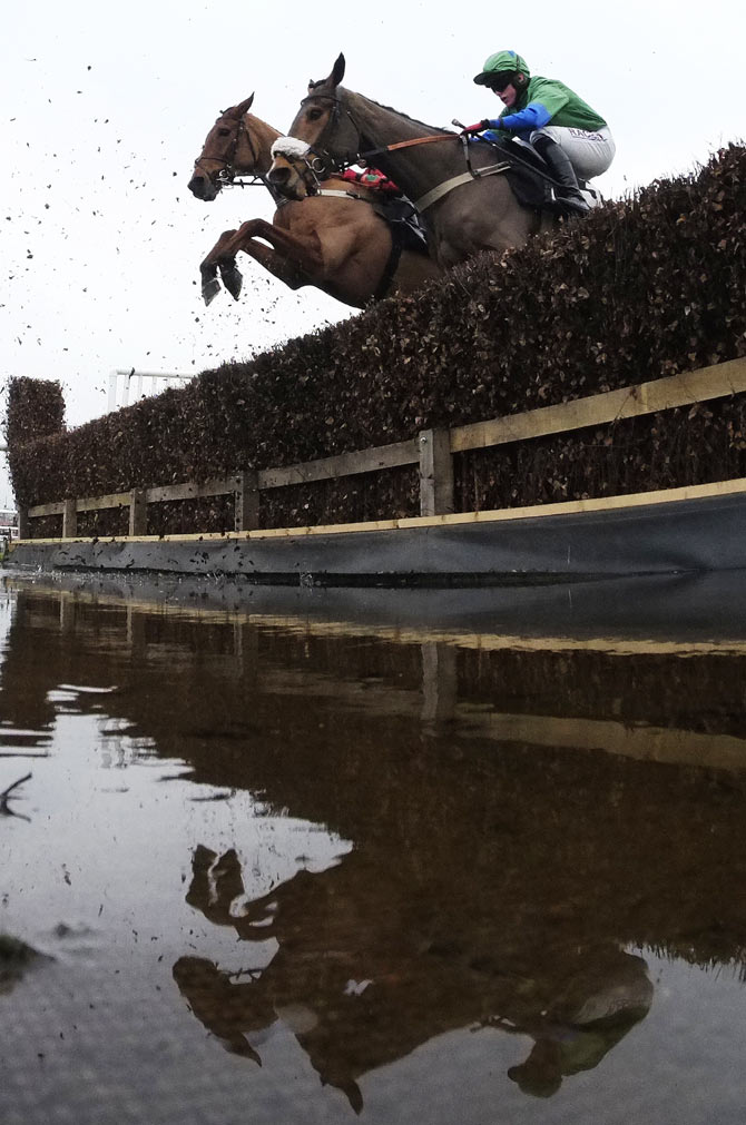 A general view as runners clears the water jump in The bet365 Conditional Jockeys' Handicap Steeple Chase at Newbury racecourse on November 28, 2014 in Newbury, England