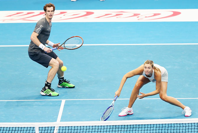 Andy Murray and Maria Sharapova of the Manila Mavericks in action against Kristina Mladenovic and Nenad Zimonjic of the UAE Royals during their doubles match at the Coca-Cola International Premier Tennis League