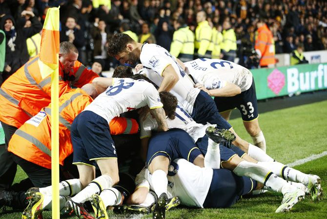 Tottenham Hotspur's Christian Eriksen (UNSEEN) celebrates scoring a goal with team-mates during their English Premier League soccer match against Hull City