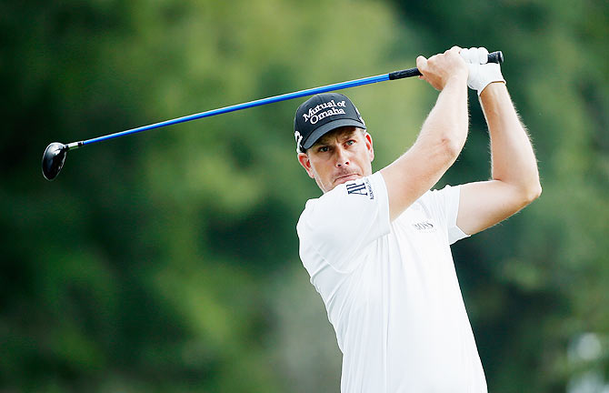 Henrik Stenson of Sweden hits his tee shot on the 12th hole during the final round of the Hero World Challenge