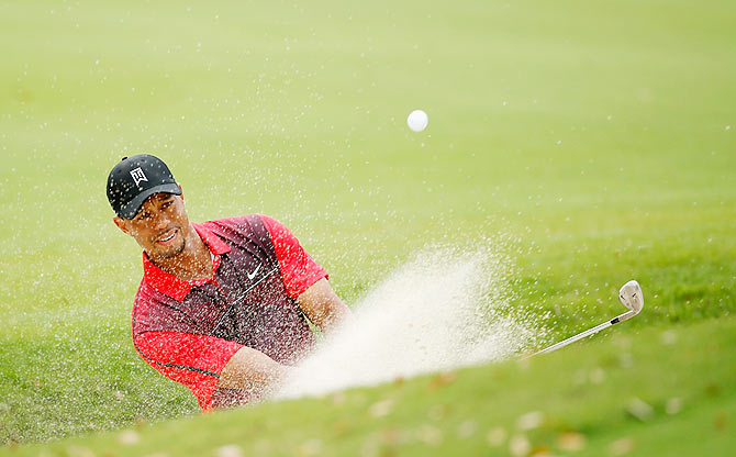 Tiger Woods plays a bunker shot on the fourth hole during the final round of the Hero World Challenge on Sunday