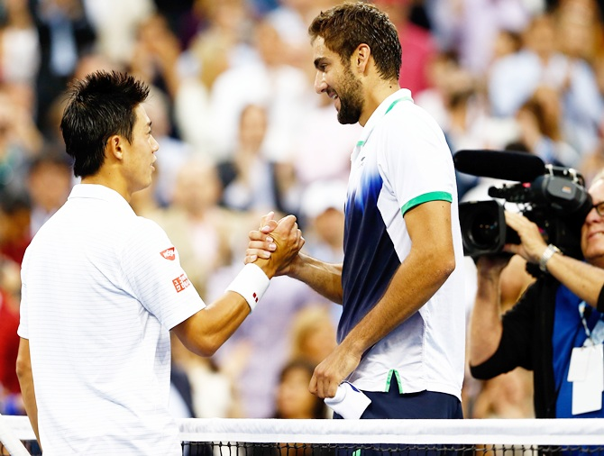 Marin Cilic, right, of Croatia greets Kei Nishikori of Japan