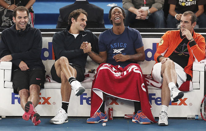 From left, Pete Sampras, Roger Federer, Gael Monfils and Cedric Pioline of the Indian Aces