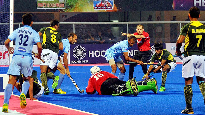 India and Pakistan players are involved in a goal-mouth melee in second semi-final of Champions Trophy at Kalinga Stadium in Bhubaneswar on Saturday