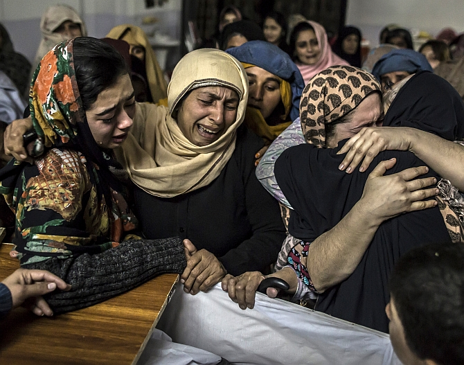 Women mourn their relative Mohammed Ali Khan, 15, a student who was killed during an attack