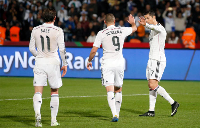 Karim Benzema (centre) celebrates scoring a goal with teammate Cristiano Ronaldo and Gareth Bale. The expensively assembled trio have frequently been blamed by the Spanish media for Real's unconvincing attacking displays this season