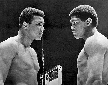 Heavyweight champion Cassius Clay (left) focuses his whammy eye on challenger Ernie Terrell