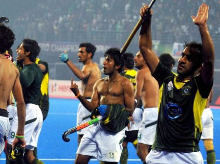 Pakistan hockey players react after winning the Champions Trophy semi-final game against India in Bhubaneswar