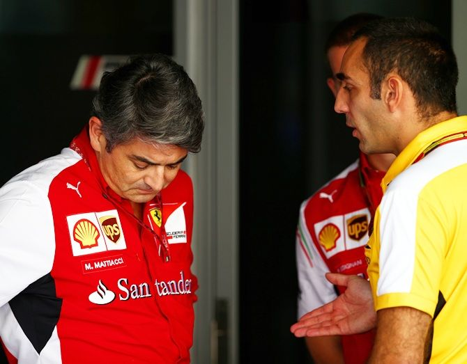 Ferrari Team Principal Marco Mattiacci speaks with Renault's Cyril Abiteboul in the paddock