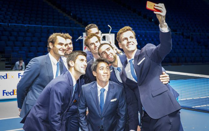 Tomas Berdych of the Czech Republic takes a group selfie of Stan Wawrinka of Switzerland,Milos Raonic of Canada,Novak Djokovic of Serbia,Kei Nishikori of Japan,Andy Murray of Great Britain,Roger Federer of Switzerland and Marin Cilic of Croatia after the mens singles official group shot had been taken prior to the start of the Barclays ATP World Tour Finals tennis previews at the O2 Arena