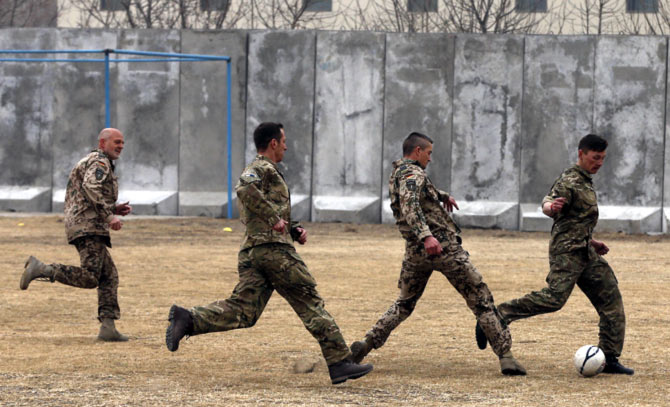 PHOTOS: Soldiers in Afghanistan play soccer in memory of World War One truce - Rediff Sports