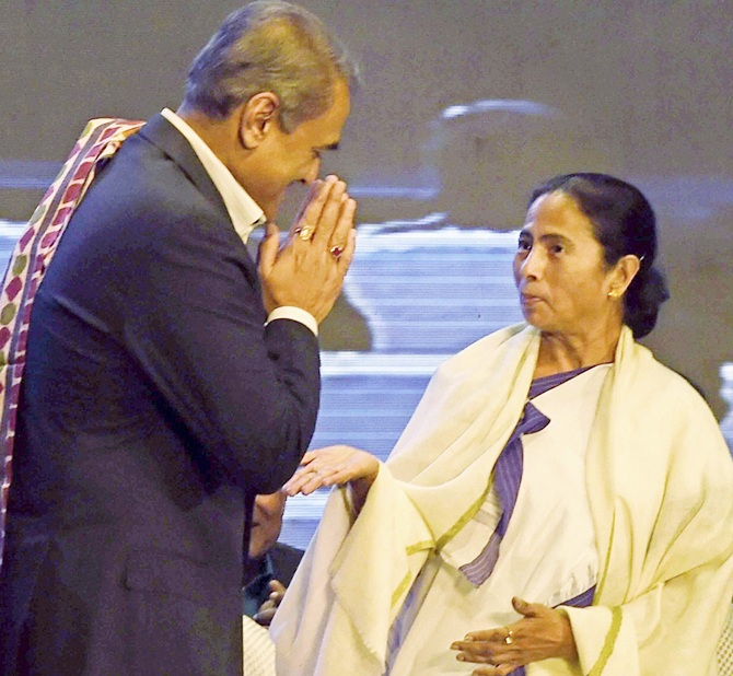West Bengal Chief Minister Mamata Banerjee with All India Football Federation president Praful Patel