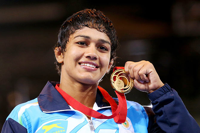 Gold medallist Babita Kumari of India poses during the medal ceremony for the Women's FS 55kg at Scottish Exhibition and Conference Centre at the Glasgow 2014 Commonwealth Games on July 31