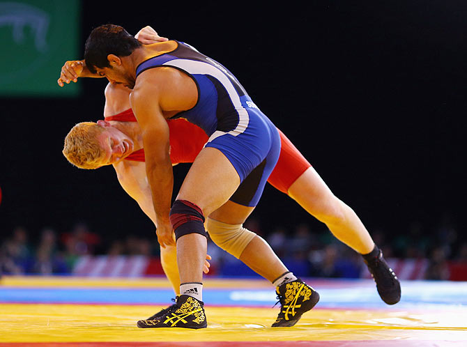 Sushil Kumar of India in action against Jayden Lawrence of Australia in the wrestling 74kg freestyle round of 16 match at Scottish Exhibition And Conference Centre during the Glasgow 2014 Commonwealth Games on July 29