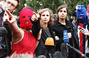 Members of protest group Pussy Riot speak during a press conference on February 20, 2014 in Sochi