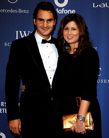 Swiss tennis player Roger Federer (left) and his wife Mirka