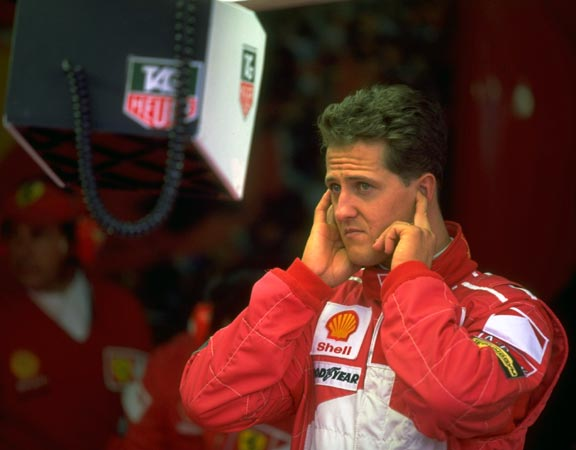 Michael Schumacher and the Ferrari team study qualifying times for the French GP. Schumacher went on to win the race, June 28, 1997.