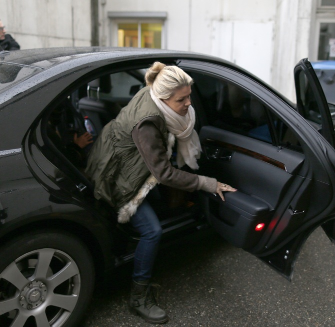 Corinna Schumacher, Michael's wife, arrives at the hospital in Grenoble, where her husband is hospitalised.