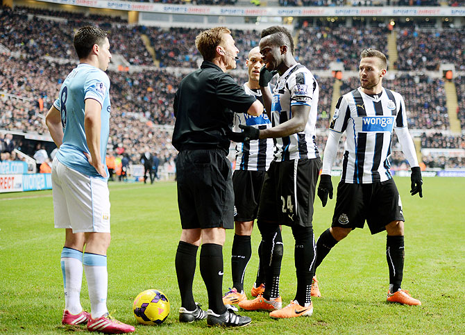 Cheik Ismael Tiote of Newcastle remonstrates with Referee Mike Jones after his goal is disallowed for being offside during the Barclays Premier League match at St James' Park in Newcastle upon Tyne on Sunday