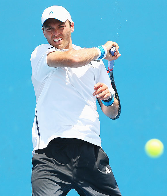 Ross Hutchins of Great Britain plays a forehand in his first round doubles match with Colin Fleming of Great Britain against Marinko Matosevic of Australia and Michal Przysiezny of Poland on Wednesday