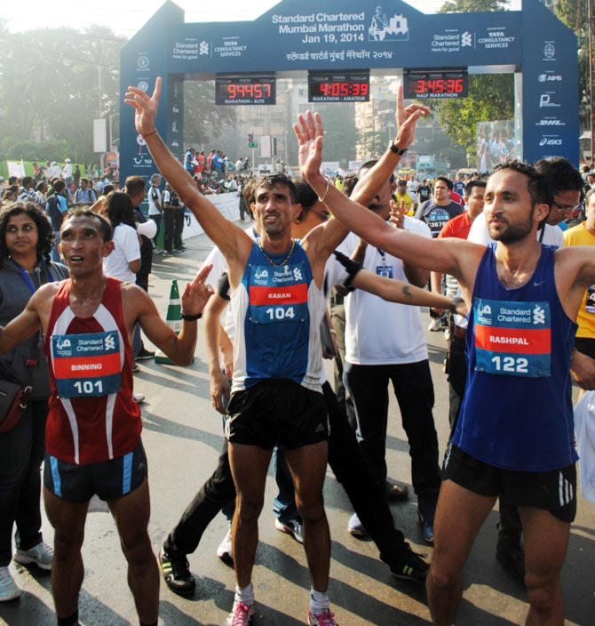 Karan Singh, Rashpal Singh and Binning Lyngkhoi celebrate after crossing the finish line