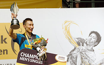 Lee Chong Wei of Malaysia celebrates with the Champions Trophy after he defeated Tommy Sugiarto of Indonesia in the final of the Malaysia Badminton Open in Kuala Lumpur, on Sunday