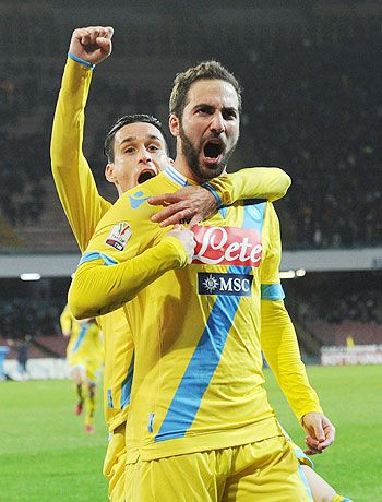 Gonzalo Higuain of Napoli celebrates after scoring the opening goal against Lazio during their Italian Cup quarters at Stadio San Paolo in Naples on Wednesday