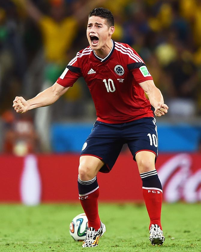 James Rodriguez of Colombia celebrates scoring against Colombia