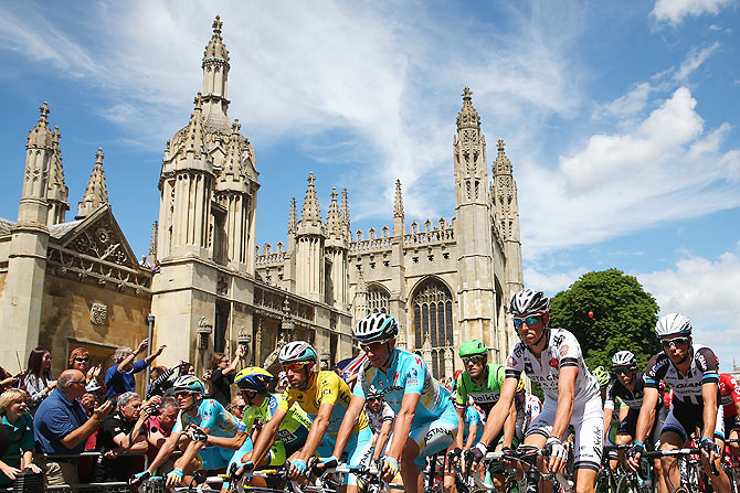 The peloton rides past Cambridge University at the start of the third stage of the 2014 Tour de France, a 155km stage between Cambridge and London, on Monday