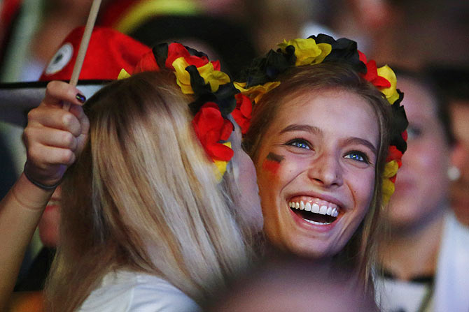 Germany fans celebrate after Thomas Mueller scores the opening goal against Brazil on Tuesday