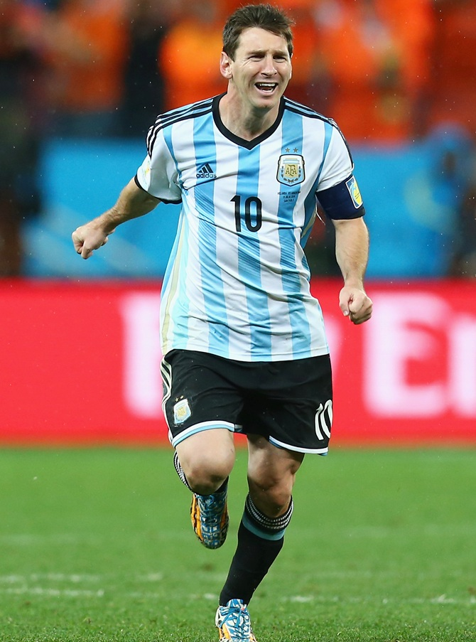 Lionel Messi of Argentina celebrates defeating the Netherlands in a shootout