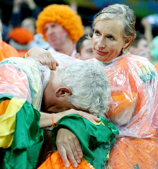 A dejected the Netherlands fan looks on after being defeated by Argentina in a penalty shootout