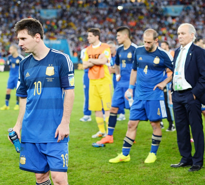 A dejected Lionel Messi of Argentina looks on with his team