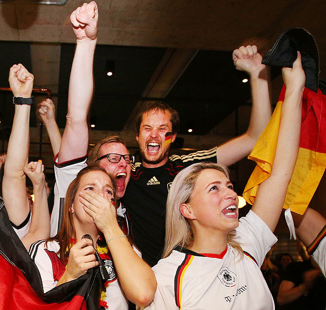 German fans at Hophaus celebrate the win as the cup gets lifted while watching the 2014 FIFA World Cup final against Argentina in Melbourne, Australia, on Sunday