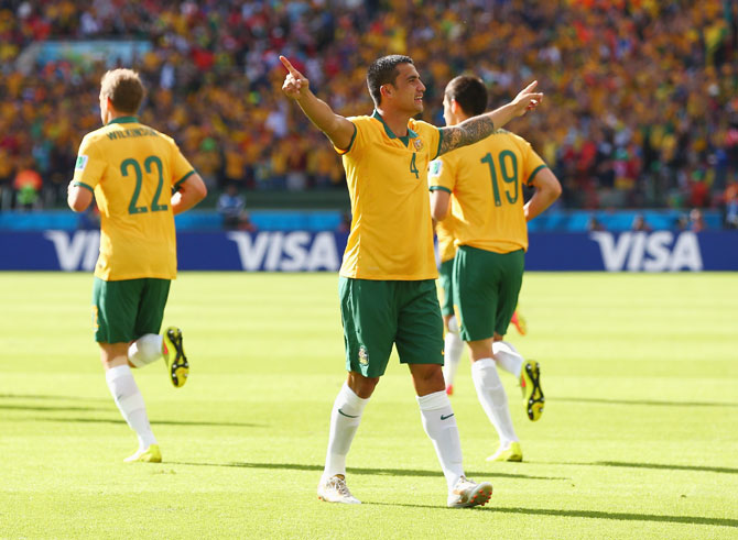 Tim Cahill of Australia celebrates after scoring his team's first goal against the Netherlands