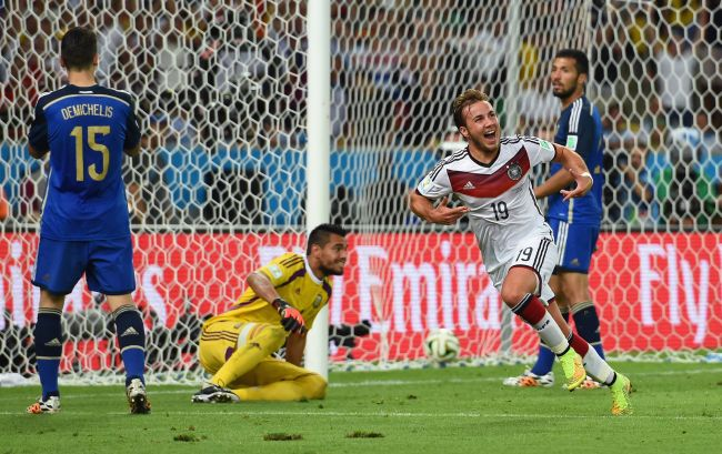 Mario Goetze of Germany celebrates scoring his team's first goal in extra time