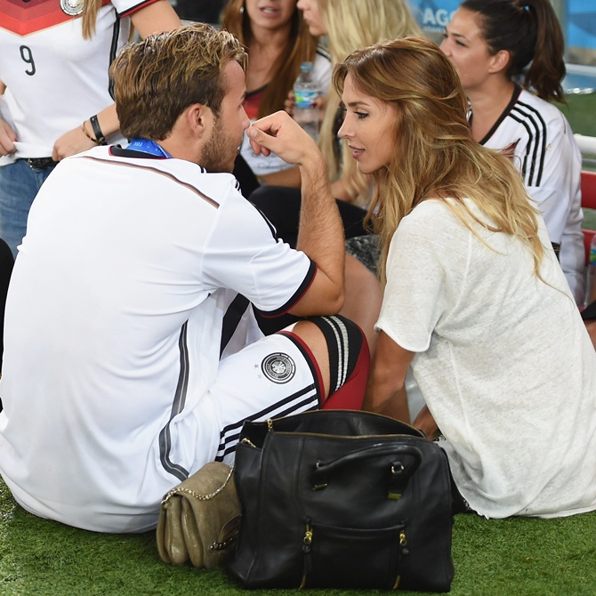 Mario Goetze of Germany celebrates with girlfriend Ann-Kathrin Brommel