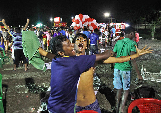 Fans of Germany celebrate in Kolkata after the 2014 World Cup final on Sunday