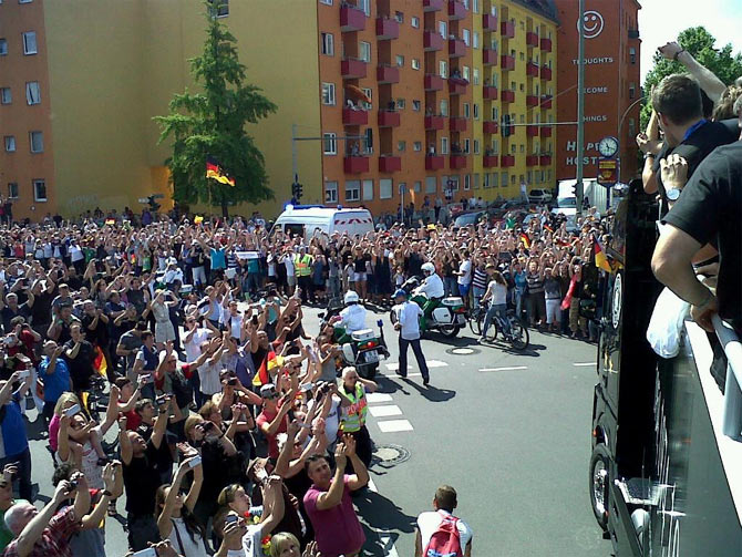 Crowds welcome the team bus at Fan Mile in Berlin on Tuesday