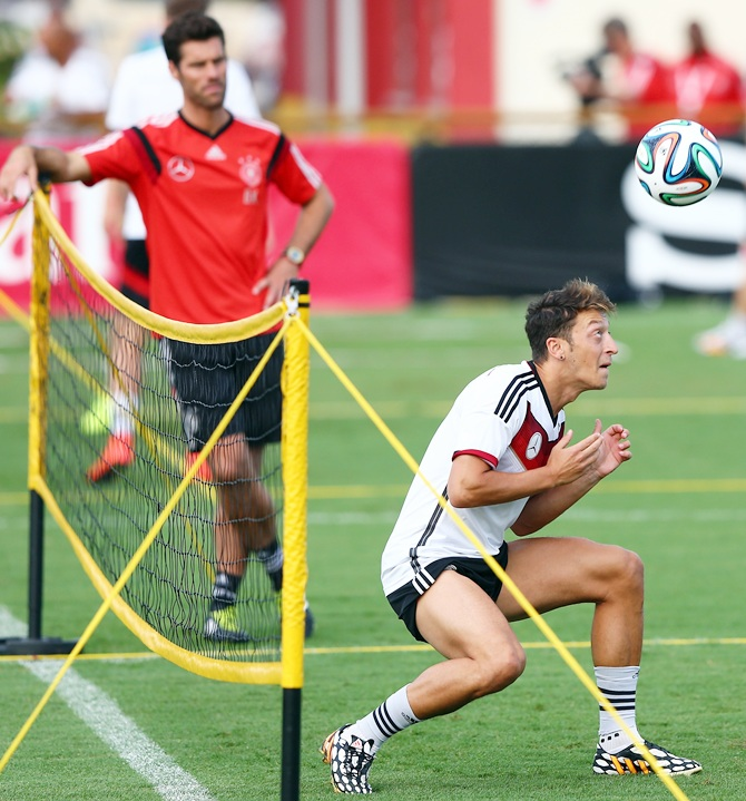 Mesut Oezil of Germany controls the ball during the German national team training session